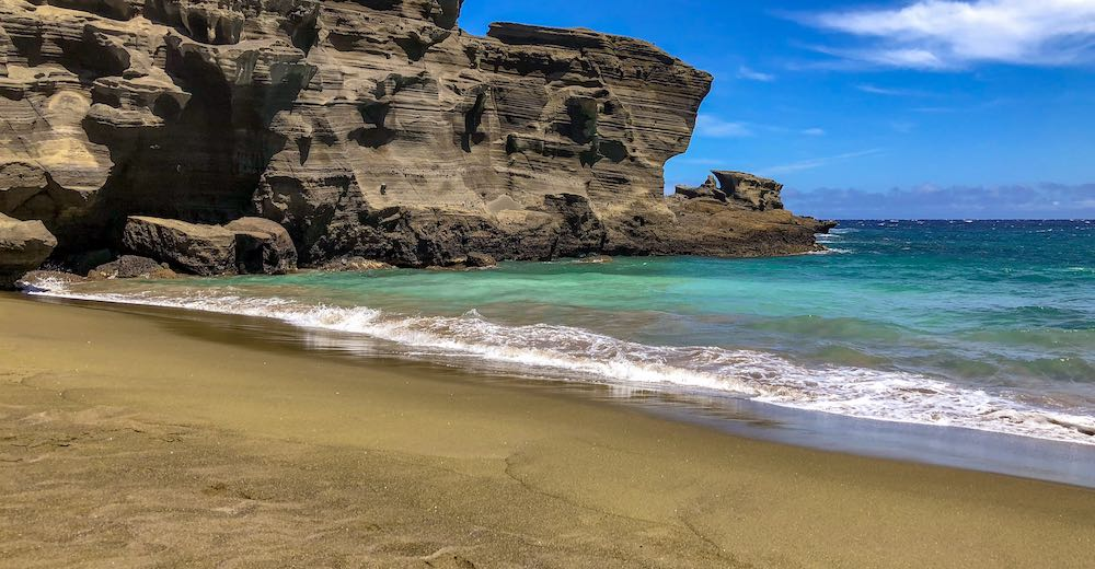 Papakolea green sand beach is hard to reach so keep that in mind when researching where to stay in Big Island Hawaii