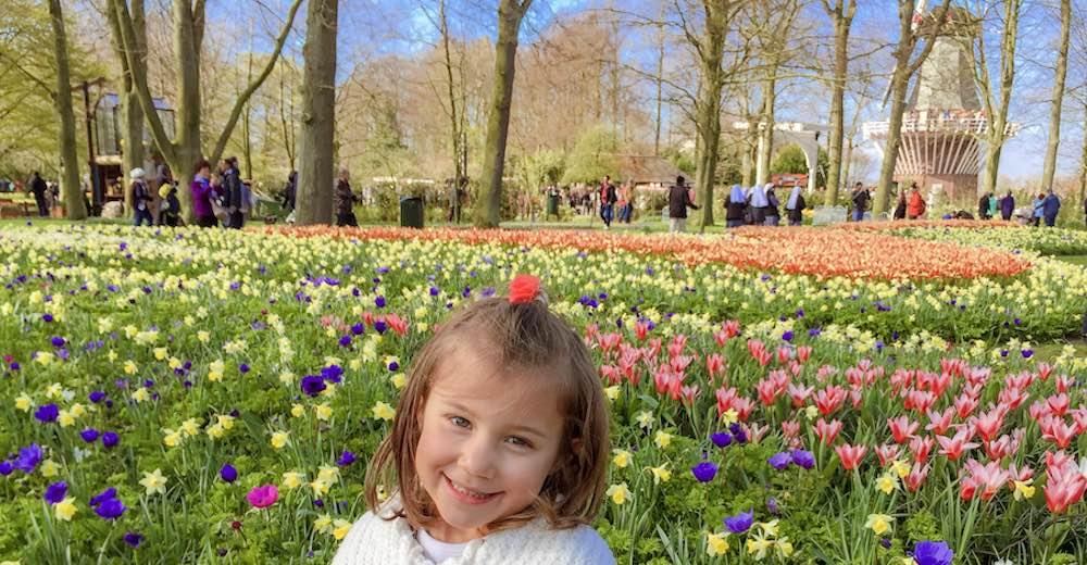 Little girl amidst the tulip fields in the Netherland's famous Keukenhof Gardens