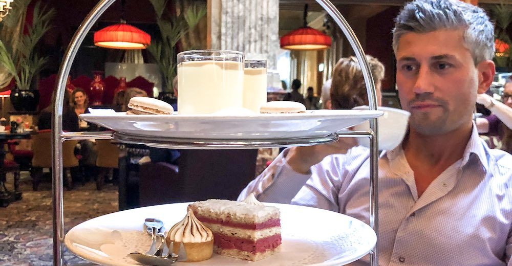 My husband enjoying his high tea at the Hotel des Indes in The Hague
