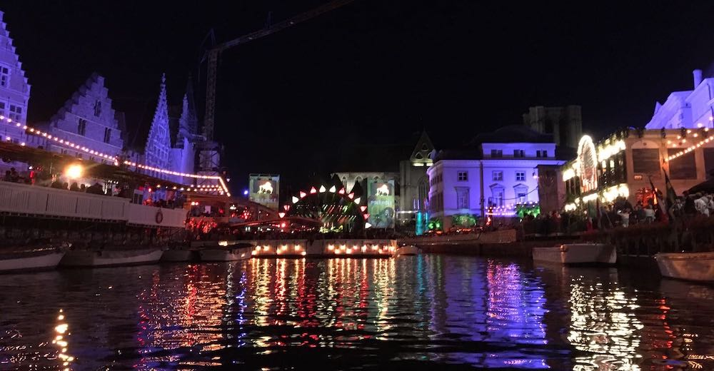 View over the Korenmarkt and Grasmarkt from the water during the Ghent Festival, one of the coolest Ghent things to do