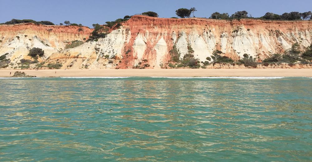 View from the water over Praia da Falésia beach, one of the most popular Portugal beaches