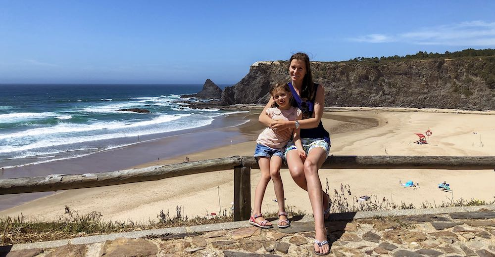 Mother and daughter at Praia de Odeceixe beach in Portugal