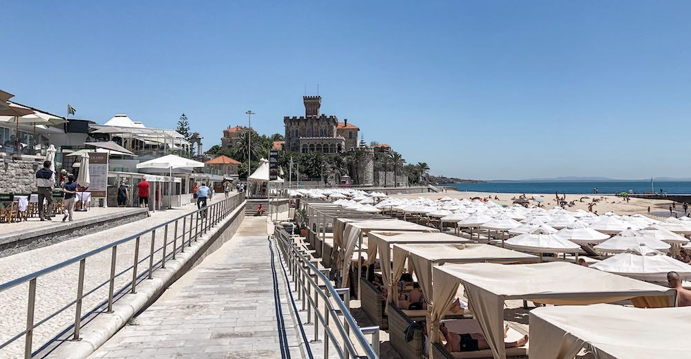 Walking the paredão boardwalk from Cascais to Estoril along the Estoril coastline is one of the things to do in Cascais