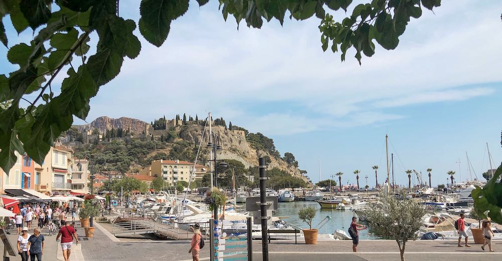 View over the Chateau de Cassis in the South of France from one of the terraces at the harbour