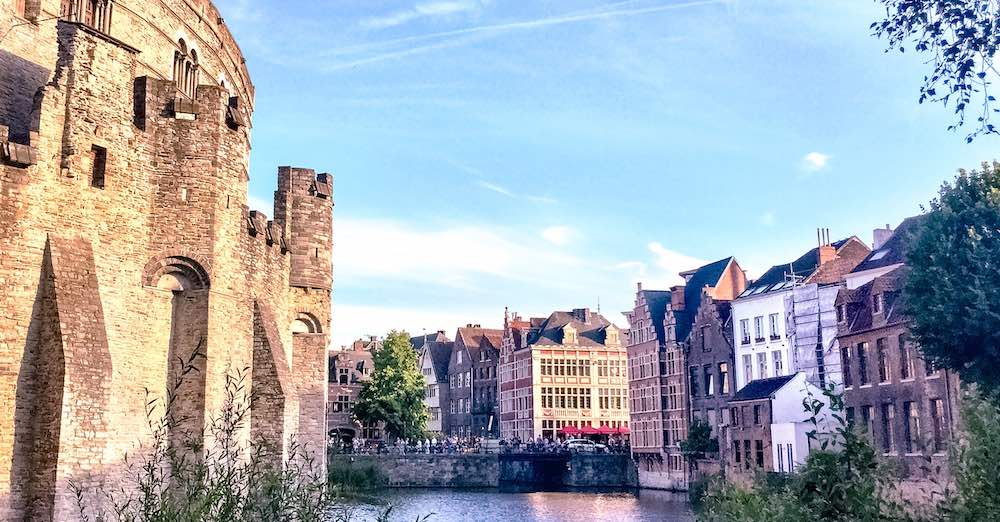 View from behind the wall of the Castle of the Counts over the water and the merchant houses in Belgium city of Ghent