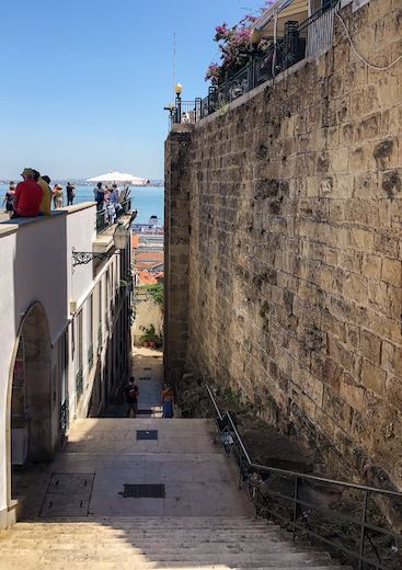 Narrow staircase in Lisbon's Alfama district, one of the most charming places to visit in Portugal