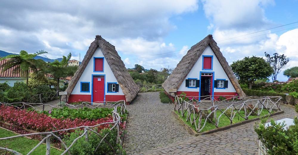 Two traditional thatched houses in the town of Santana on the island of Madeira