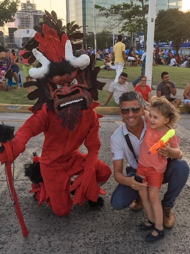 Dad and his girl posing with a diable sucio at Panama City carnaval