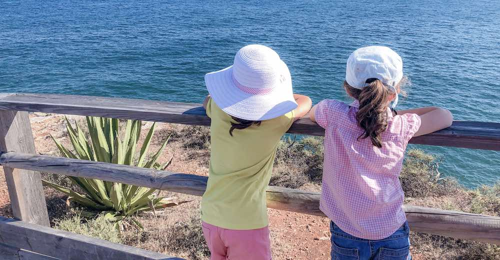 Two little girls overlooking the Atlantic from the Carvoeiro Boardwalk to Algar Seco