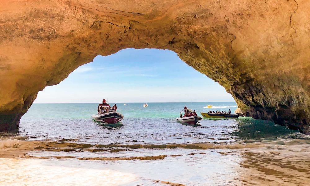 Two boats entering the Benagil Algarve cave Portugal