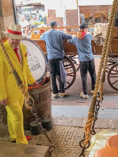 Farmers bringing the Gouda cheese to the weighing house at Gouda cheese market