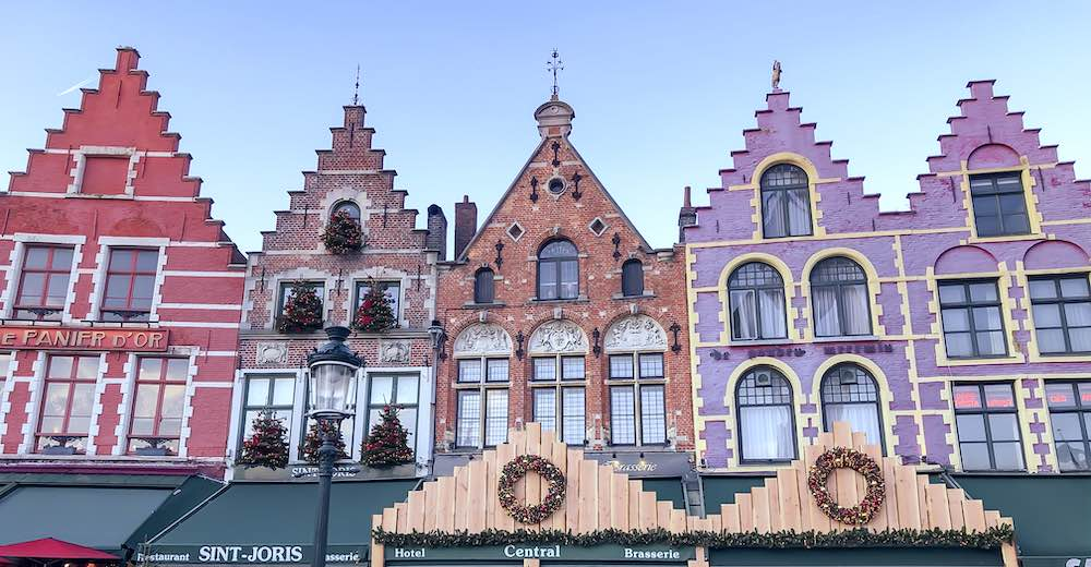 Stepped-gable gingerbread houses during Christmas in Bruges which hosts the most famous Belgium Christmas market