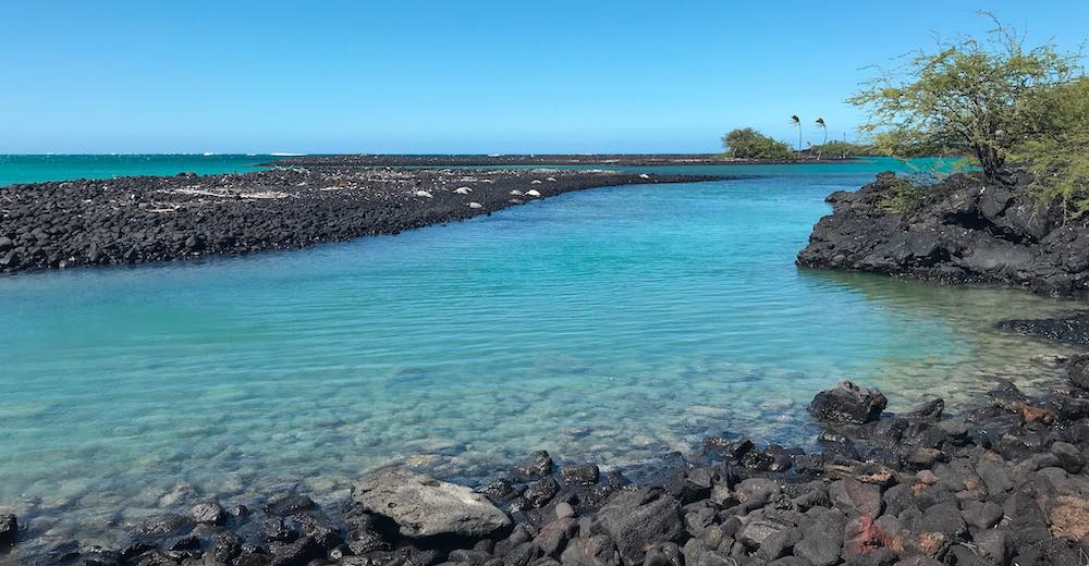 Kiholo Bay is home to one of the most beautiful black sand beaches Hawaii