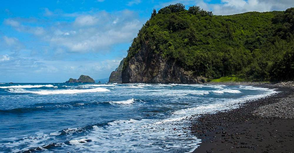 Polulu valley is home to a gorgeous black sand beach in Hawaii