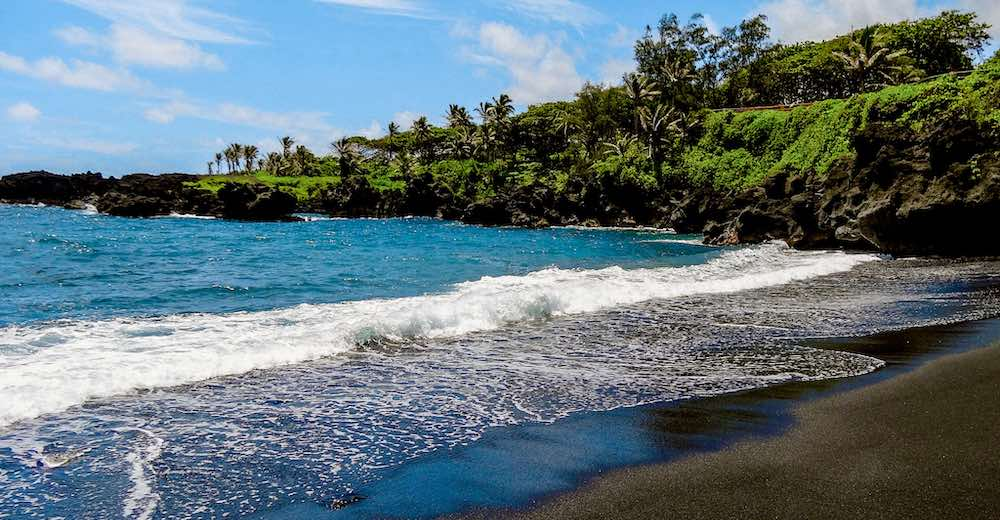Honokalani beach in Wai'anapanapa State Park is the only black sand beach in Maui