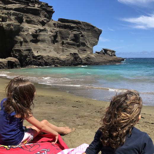 Big Island is the best Hawaii island for families looking to discover the natural highlights of Hawaii like this green sand beach