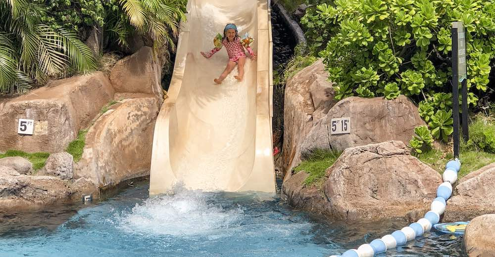 Girl coming down the slide at the Westin Maui Resort pool