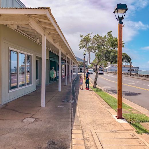 A father and his daughter exploring Lahaina town