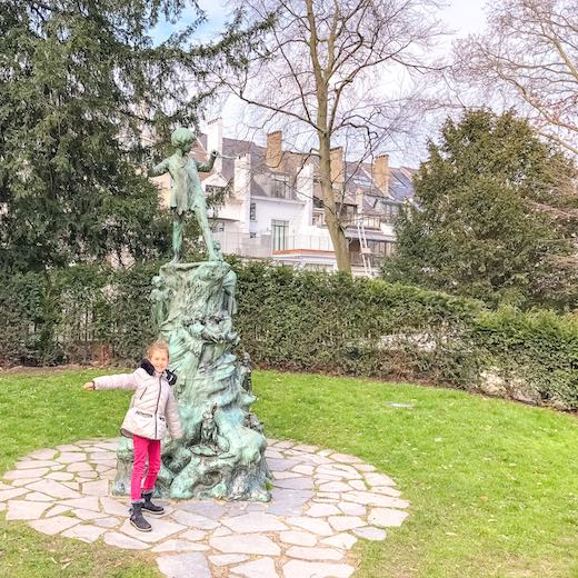 Little girl at a statue at Egmont Park