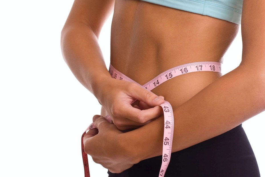 How to lose weight, woman measuring her abs