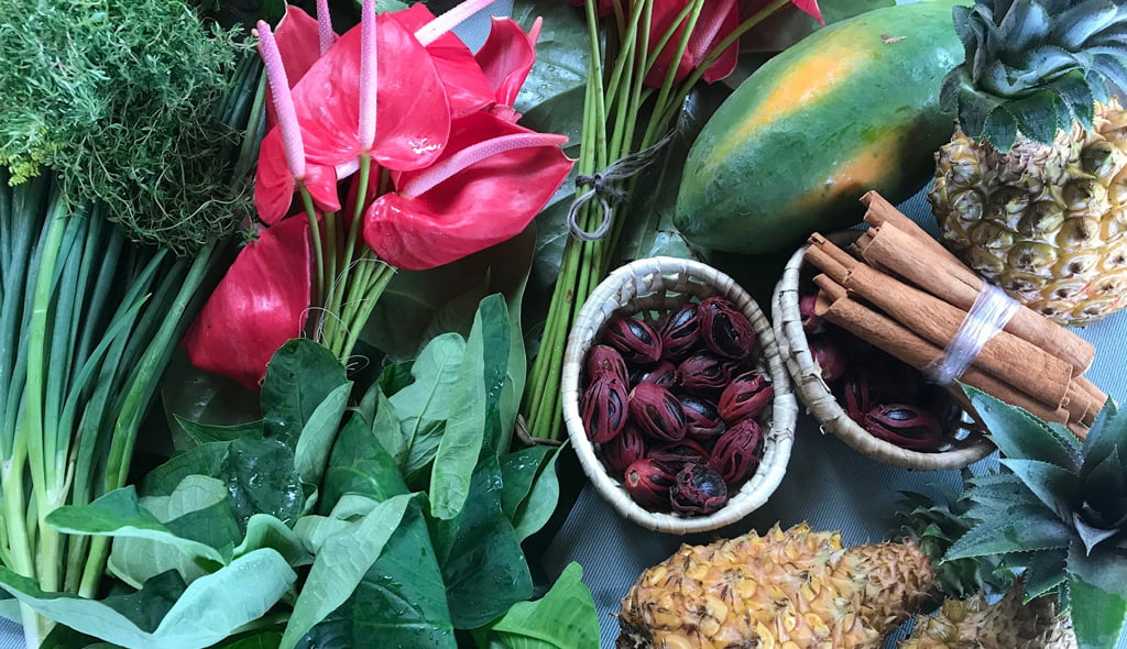 A selection of flowers, fruit and spices in Soufriere market