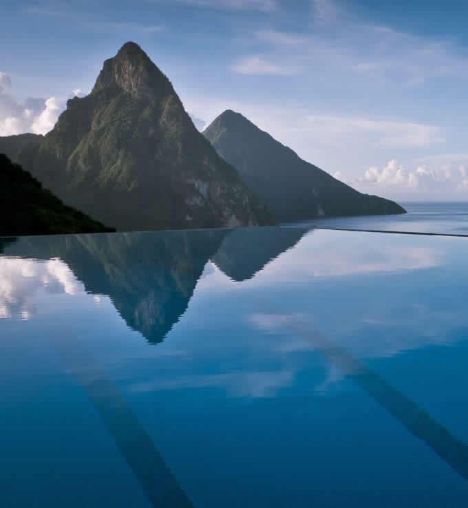 The Pitons UNESCO World Heritage site reflected in the pool at Cosmo