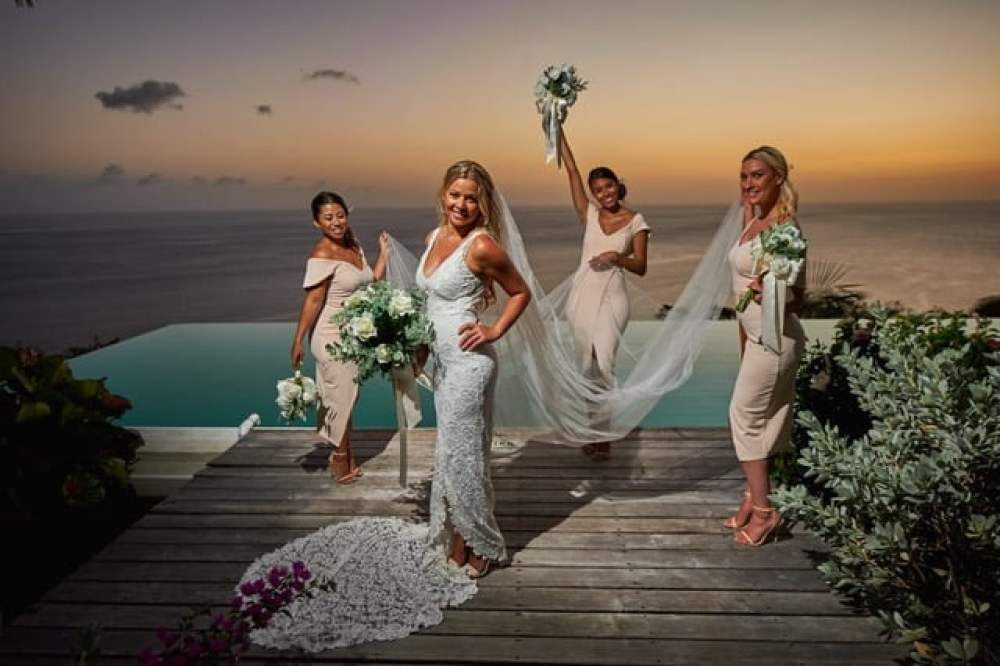 A bride with her bridesmaids at Cosmos St lucia, with a setting sun behind them