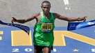 Geoffrey Mutai finishing the 2011 Boston Marathon.  His time of 2 hours 3 minutes and 2 seconds set a new record of the fastest marathon ever. (Photo: http://www.npr.org)
