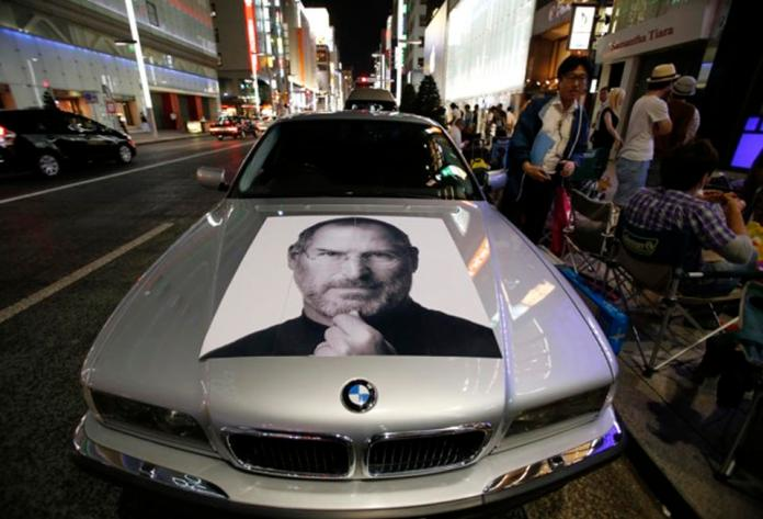 A portrait of Apple's co-founder Steve Jobs is seen on a BMW car. The only Apple Car we are likely to see. Photo Toru Hanai/Reuters)