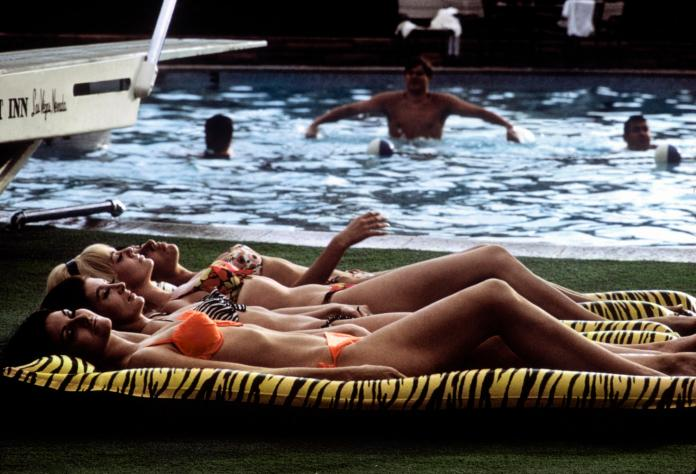 Burt Glinn Four sunbathers on leopard skin-printed rafts. Las Vegas, Nevada, USA. 1968.