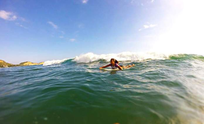 Silvana, surfing in Ecuador. Photo by author.