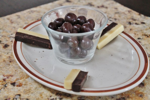 Chocolate-covered coffee beans and sticks of white and dark chocolate