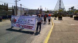 """Un reducido grupo de manifestantes se pronunciaron contra la reforma energética, que consideran una """"privatización disfrazada"""""""