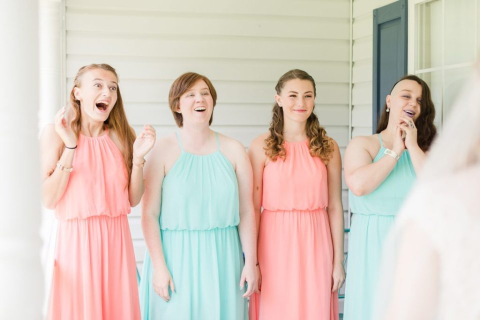 bridesmaids seeing bride for the first time by Costola Photography