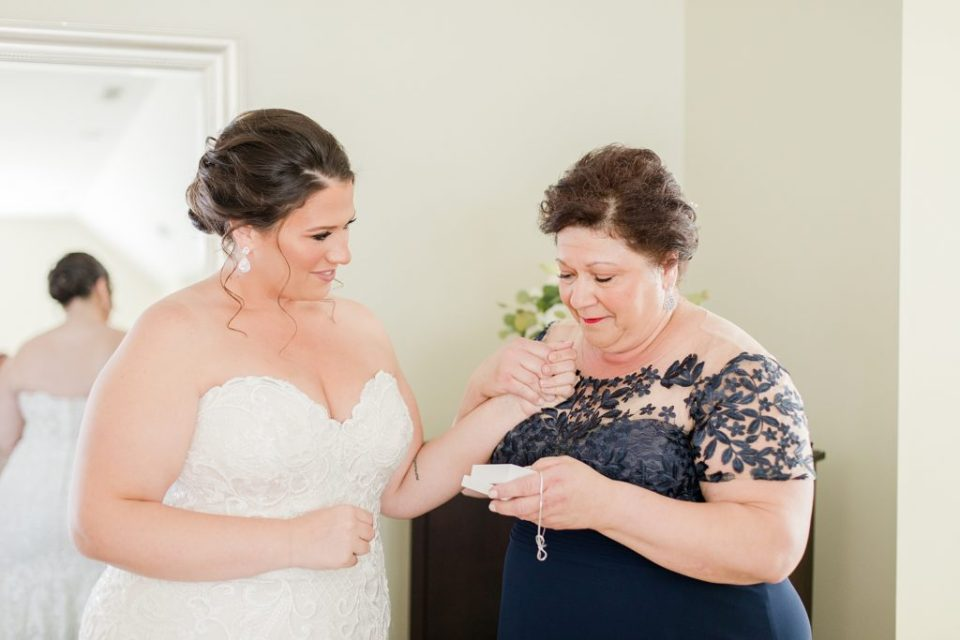 bride getting ready at waterfront weatherly farm wedding by Costola Photography