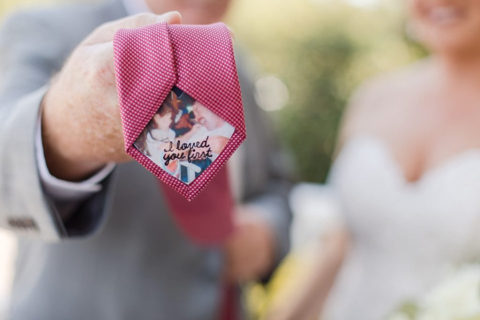 bride giving gift to dad at waterfront weatherly farm wedding by Costola Photography