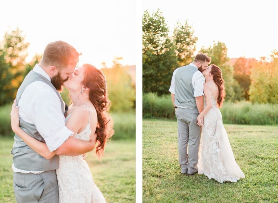 Bride and Groom kissing in field in classic Tennessee wedding by Costola Photography