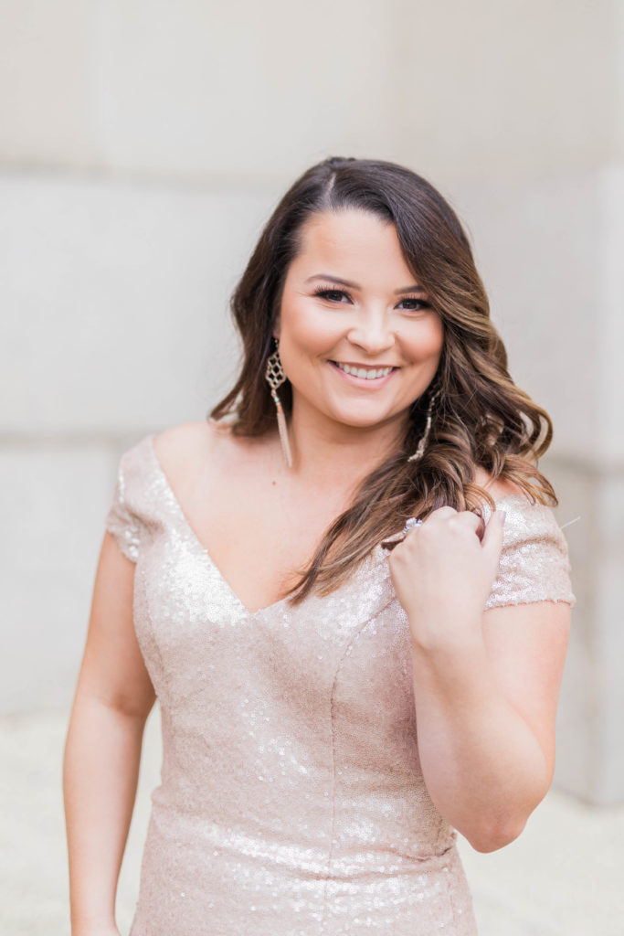 head shot of woman in washington dc with marble background and sequin dress by costola photography