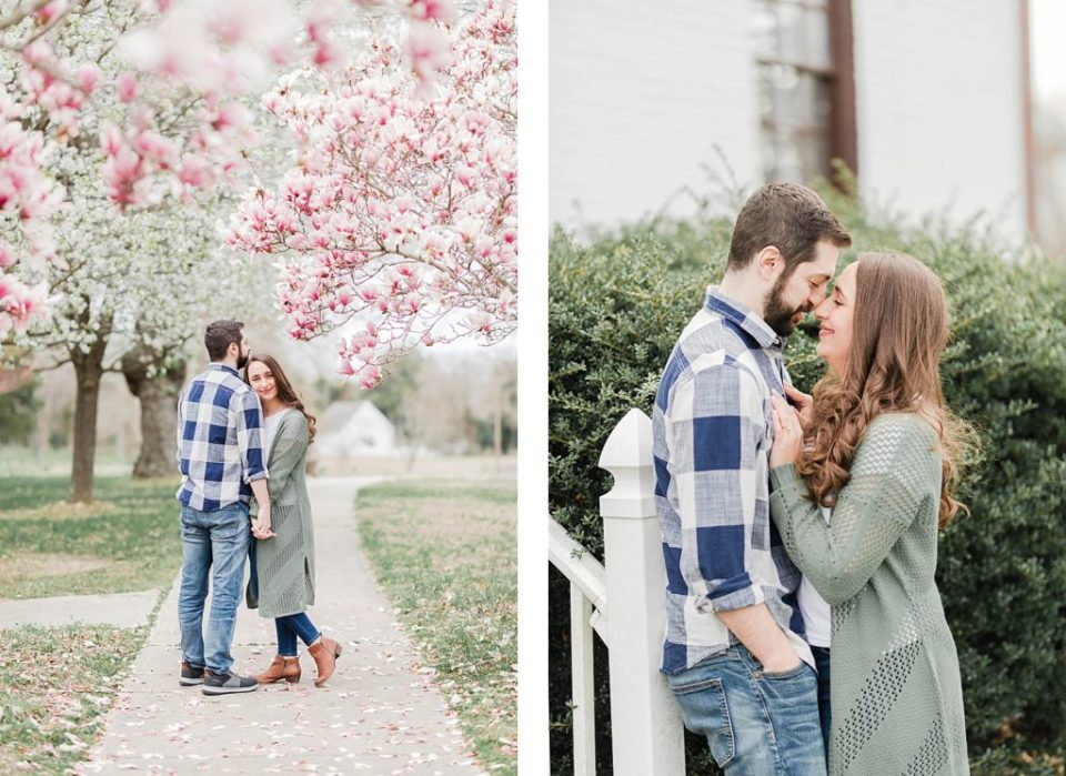 Couple standing under cherry blossom blooms in southern maryland for engagement session by Costola Photography