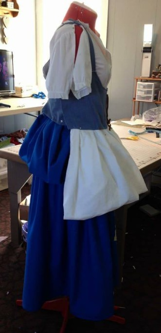 """blue """"pouch"""" with white apron"""