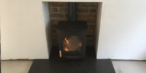 Charnwood C4 Stove installation in Street with Slate Hearth