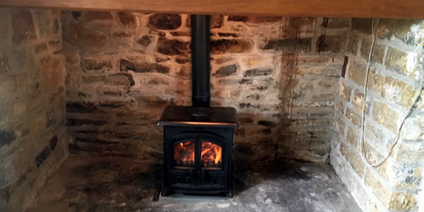 wood burner installation in street hetas