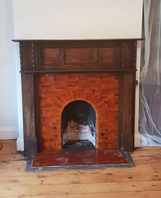 Remove old fire surround and prepare for woodburner installation in Minehead