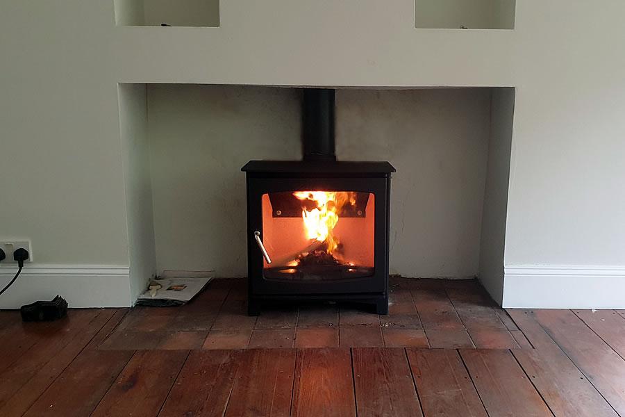 Woodburner installation in Holford