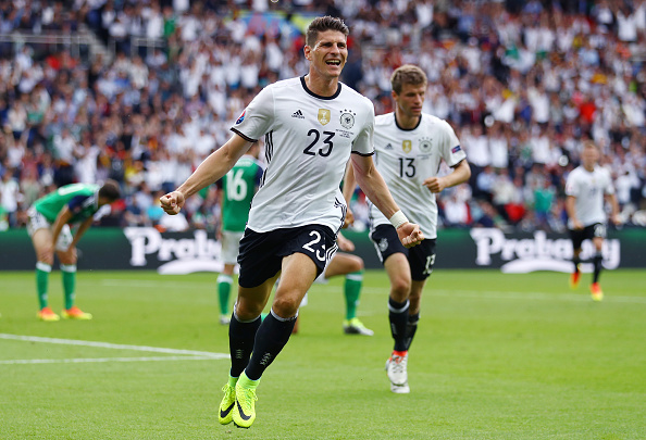 PARIS, FRANCE - JUNE 21: Mario Gomez of Germany celebrates scoring the opening goal during the UEFA EURO 2016 Group C match between Northern Ireland and Germany at Parc des Princes on June 21, 2016 in Paris, France. (Photo by Clive Mason/Getty Images)