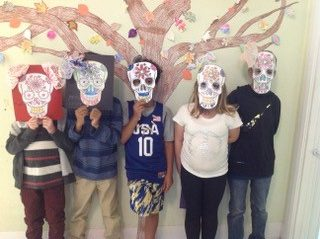 The kids made skull masks for Day of the Dead
