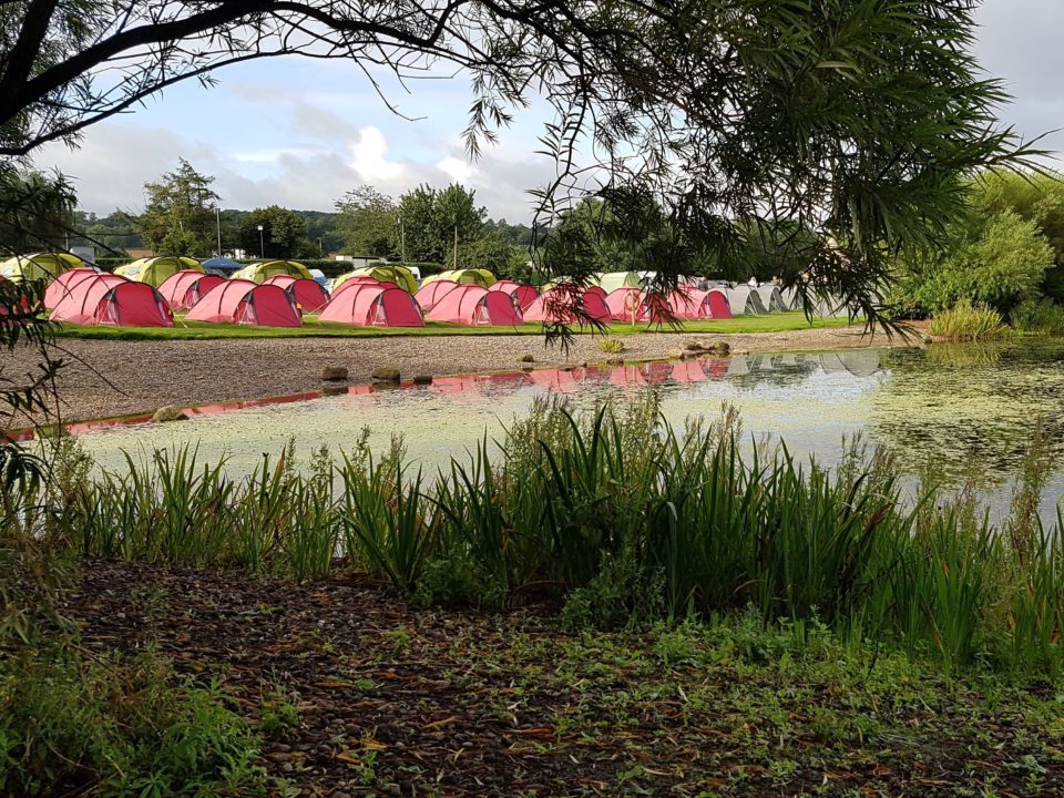 Cotswold TIpis Tents nestled by a lake