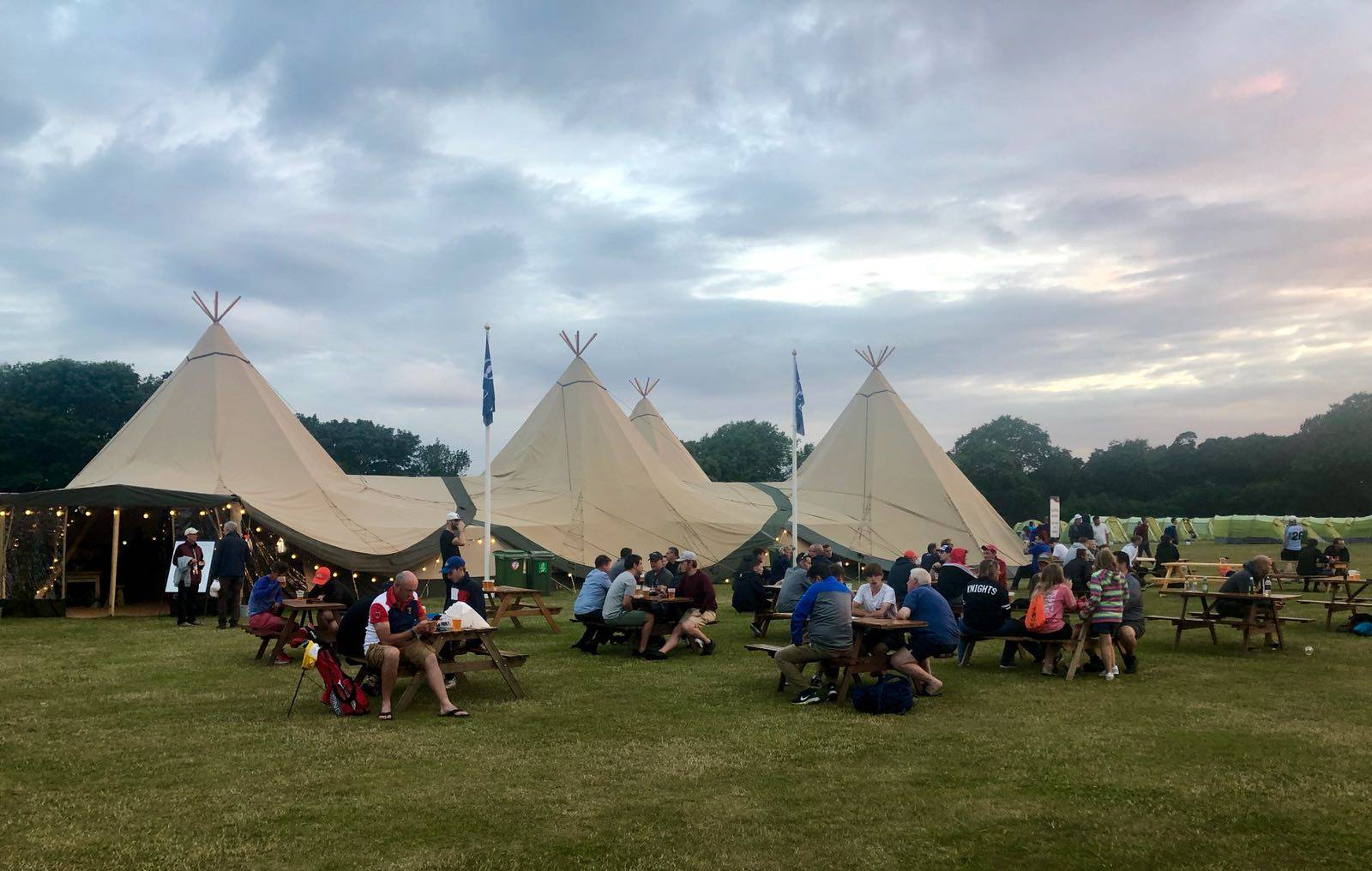Enjoying the Open Village Clubhouse made of 5 Giant Tipis
