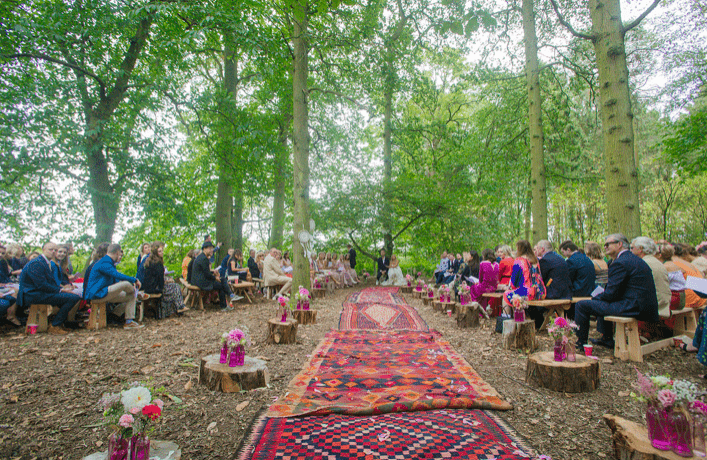 Wild woodland boho chic outdoor wedding with a giant tipi