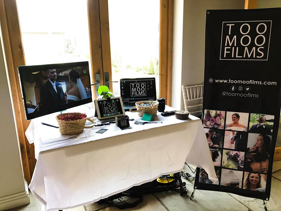 Photo of Too Moo Films display table at a Wedding Open Day. Too Moo Films are a wedding videography company based in Longford in Gloucestershire.